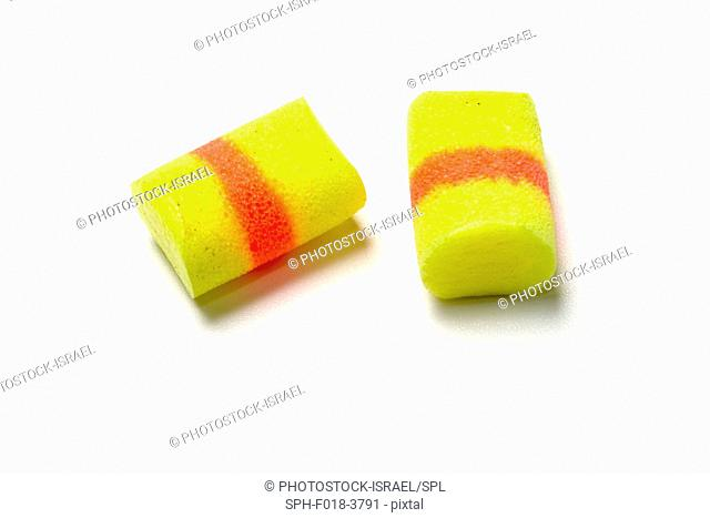 Pair of yellow earplugs used to reduce noise including noise caused by snoring