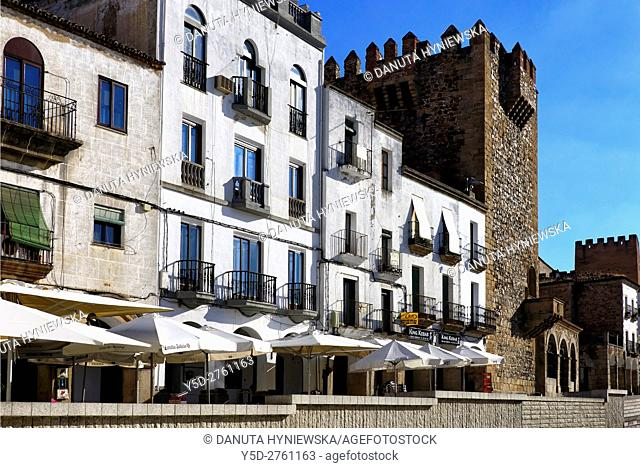 Plaza Mayor in Caceres, in front reidential buildings, on right next to townhouses Bujaco Tower and Ermita de la Paz, Old Town of Caceres, UNESCO World Heritage