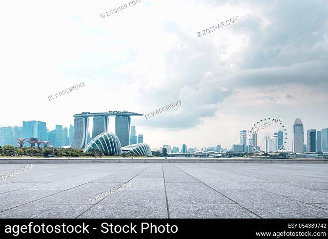 empty marble floor and cityscape of singapore in cloud sky