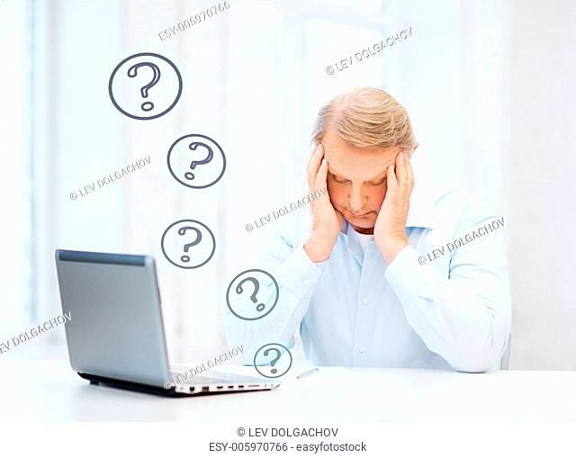 business, tax, office, school and education concept - stressed old man filling a form at home