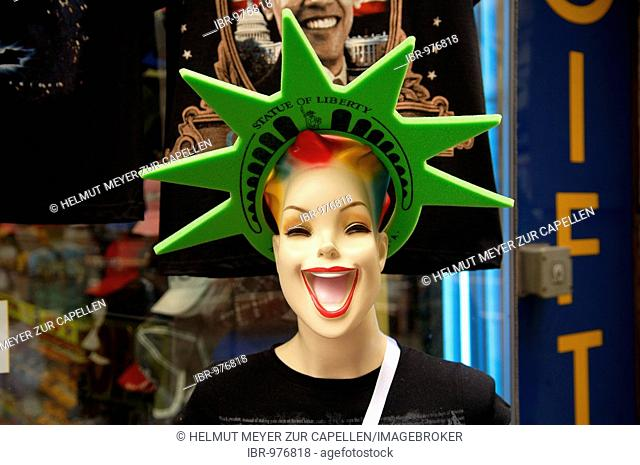Laughing female window display dummy with star wreath, Statue of Liberty, New York City, USA
