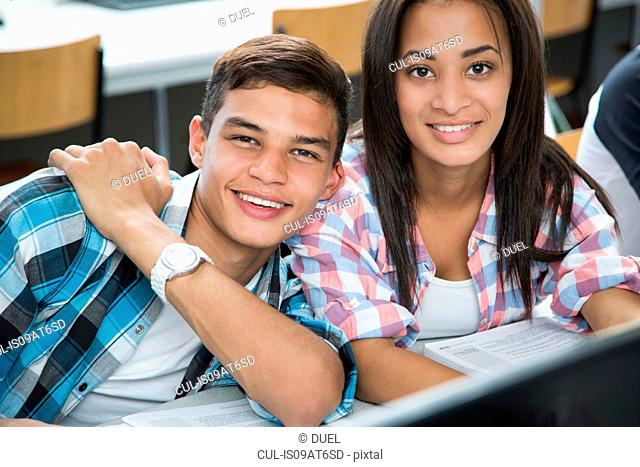 Portrait of teenage boy and girl in high school computer class