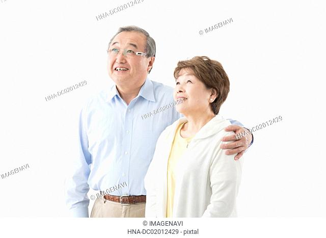 Senior couple looking up