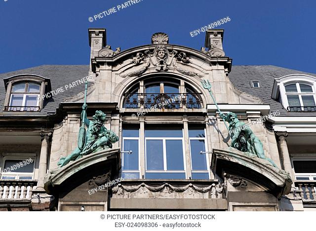 Statues on the Hansahuis on the Suikerrui in Antwerp, Belgium