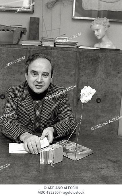 Vanni Scheiwiller seated in his studio. The editor, art critic and journalist from Milan Vanni Scheiwiller seated in his studio. Milan, 1975