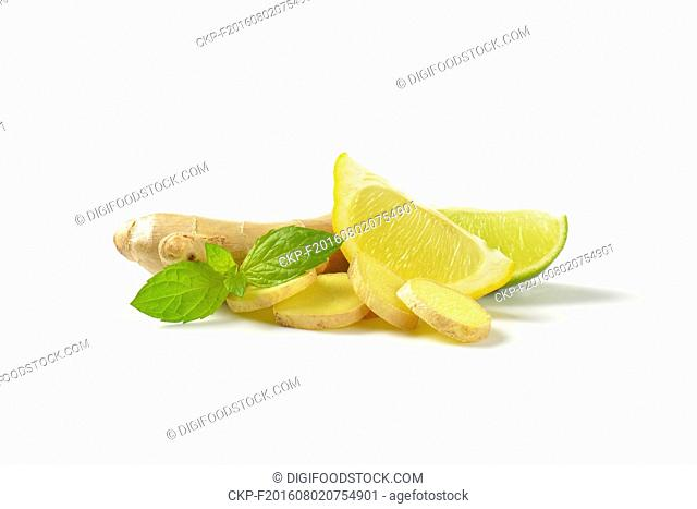fresh ginger with lemon and lime on white background