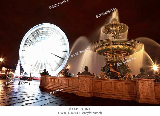 Fontaine des Mers, Christmas tree and a Ferris wheel at the Place de la Concorde in Paris