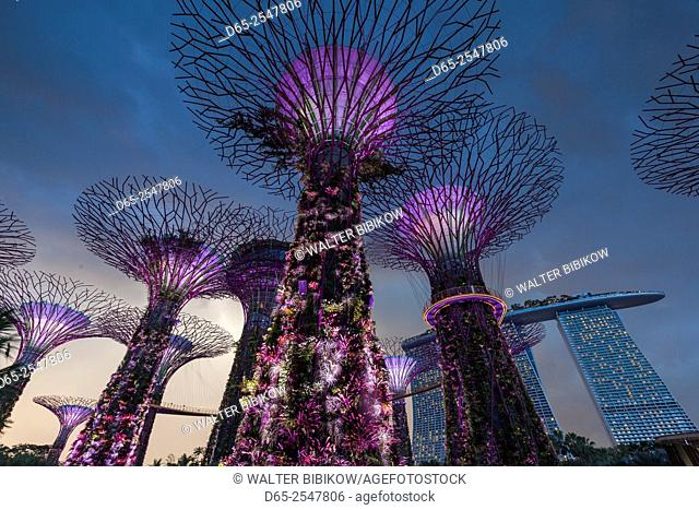 Singapore, Gardens By The Bay, Super Tree Grove and Marina Bay Sands Hotel, dusk