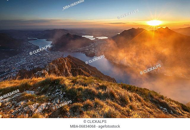 Red and foggy sunset above Lecco, lake Como, Lombardy, Italy, Europe