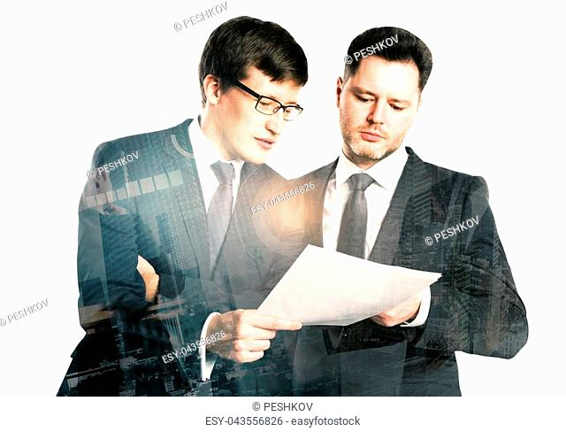 Two handsome businessmen discussing contract together on abstract city background. Teamwork and discussion concept. Double exposure
