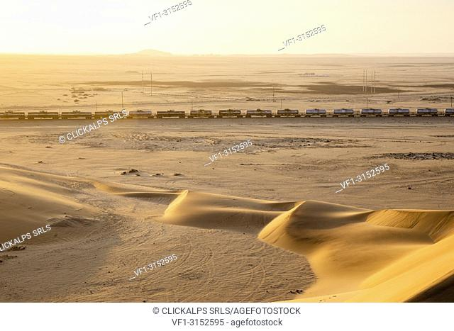 Freight train crossing the dunes of the desert at dawn,Walvis Bay,Namibia,Africa