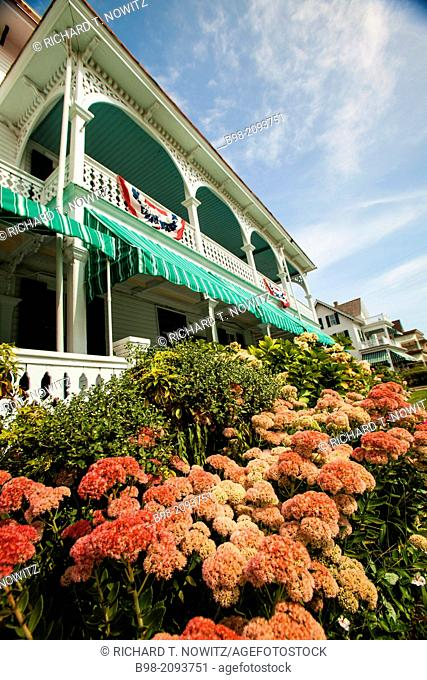 Front porches of the Victorian seaside Chalfonte Hotel, where guest can sit in rocking chairs, and appreciate bygone days.