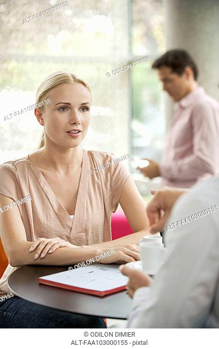 Woman meeting with colleague in cafe