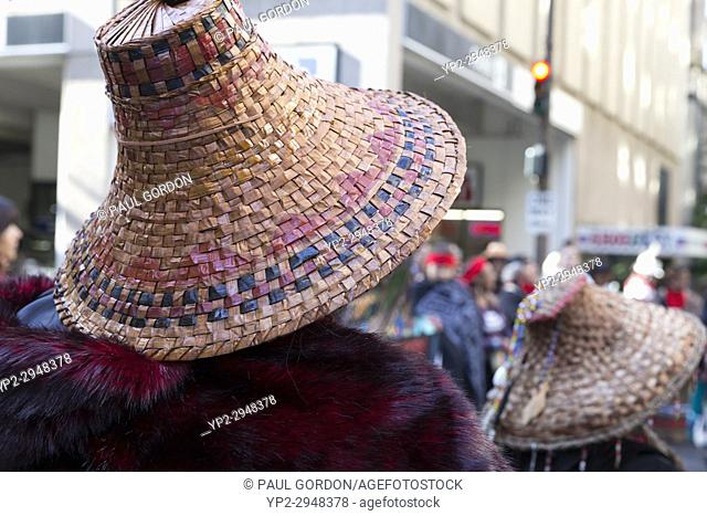 Seattle, Washington: Tribe members with cedar bark hats during march from Westlake Park to Seattle City Hall at the Indigenous Peoples' Day March and...