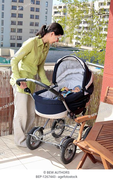 Mother with an infant in a pram