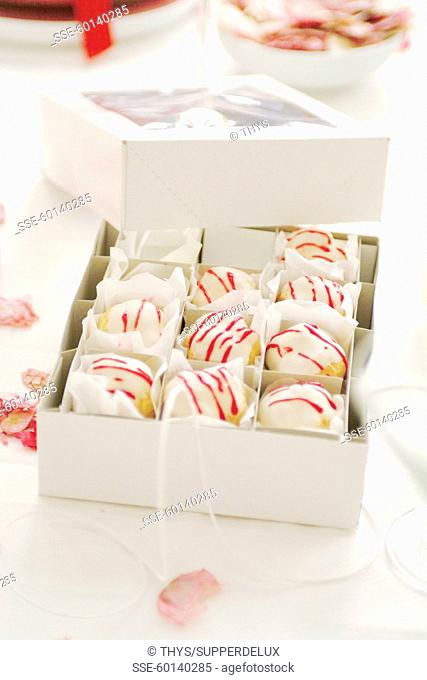 Box of cream puffs with icing suger topping