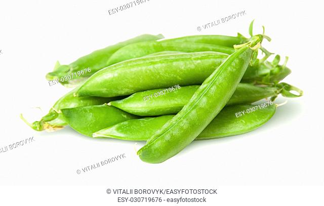 Pile of fresh green peas sugar in the pods isolated on white background