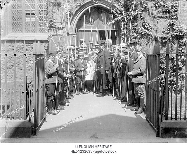 Beating the Bounds ceremony, St Michaels Church, Cornmarket Street, Oxford, Oxfordshire, 1914. A group of children with a vicar and schoolmaster