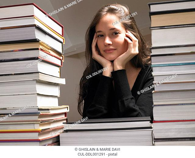 Woman resting on books