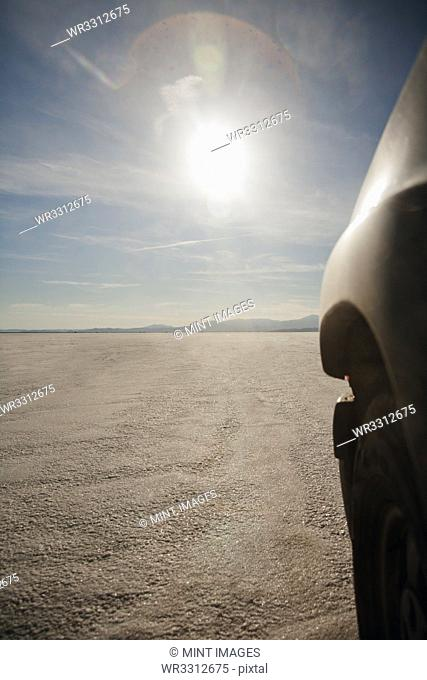 Close up of car driving on salt flats, Bonnaville Salt Flats, Utah, United States