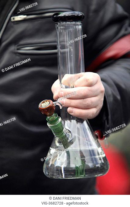 A man holds a bong filled with marijuana during the 420 Smoke Out at Yonge-Dundas Square in Toronto, Ontario, Canada. Several hundred cannabis smokers and...