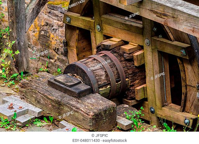 Reconstituted and restored mill wheel of an old water mill in Germany