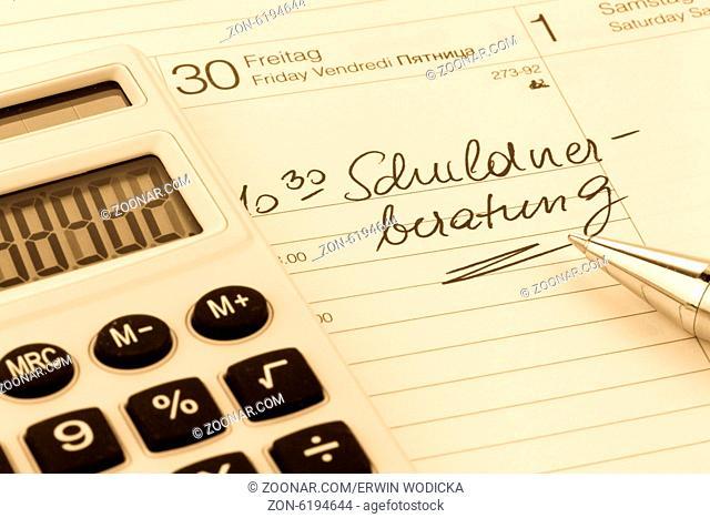 Kalender, Eintrag Schuldnerberatung, Symbolfoto für Privatinsolvenz und Armut