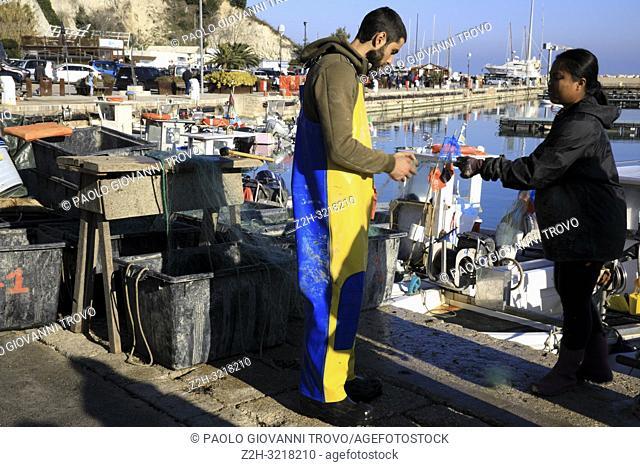 Fisherman at Numana port, Riviera del Conero, Adriatic Sea, Numana, Ancona, Marche, Italy