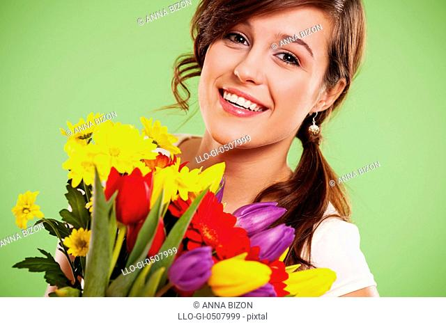 Happy young woman with flowers, Debica, Poland
