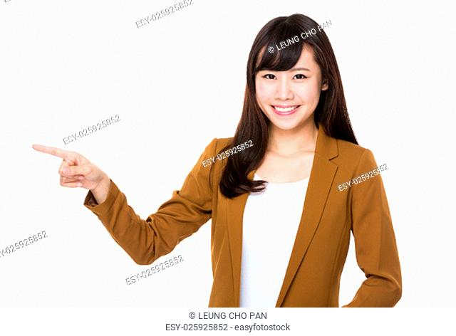 Businesswoman showing finger point aside