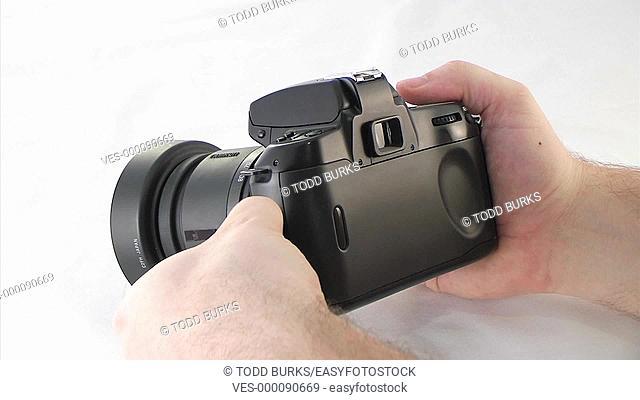 Loading film into a SLR camera