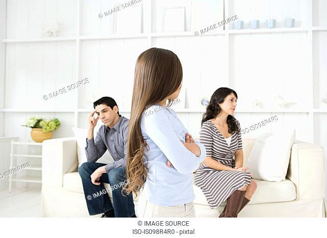 Girl looking at her hostile parents