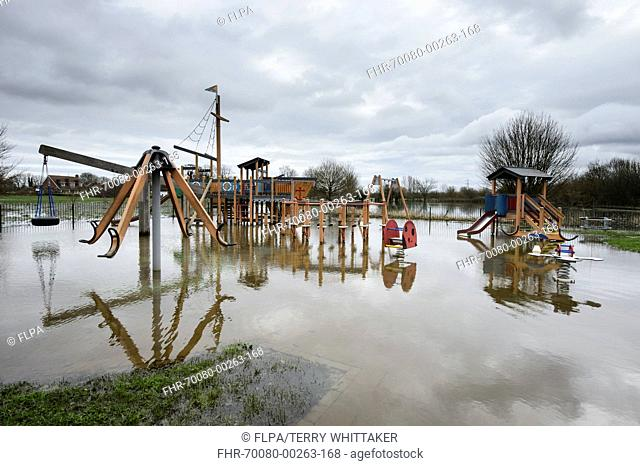 Floodwater in playground during river flood, River Thames, Chertsey, Surrey, England, February 2014