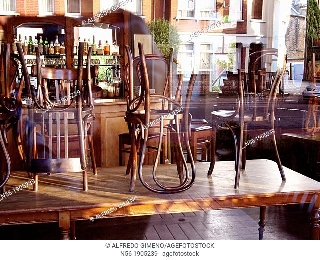 Chairs on the table, Bar in Chiswick, London