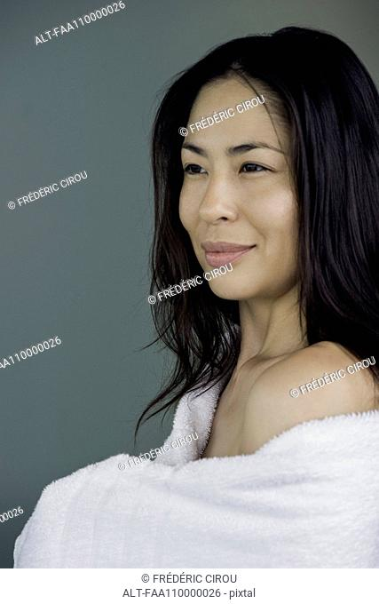 Woman wrapped in towel, portrait