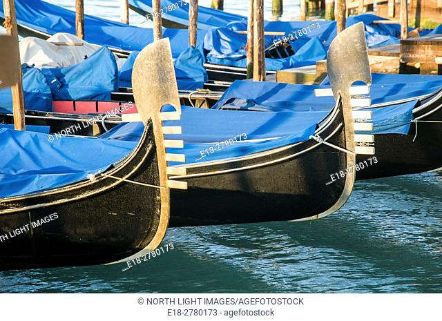 Italy, Venice. Gondolas lined up at dock on the Grand Canal