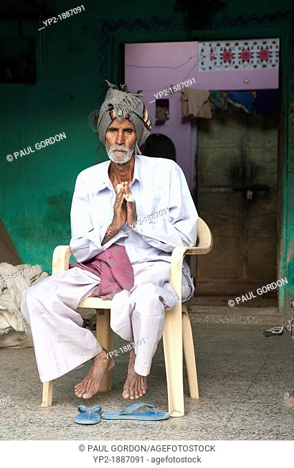 Man greets with namaste hands at his home in Achrol Village - Jaipur District, Rajasthan, India