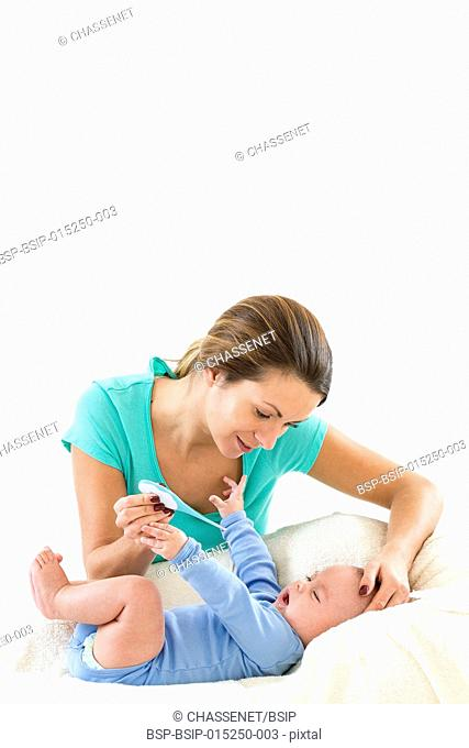 Mother measuring the temperature of her son
