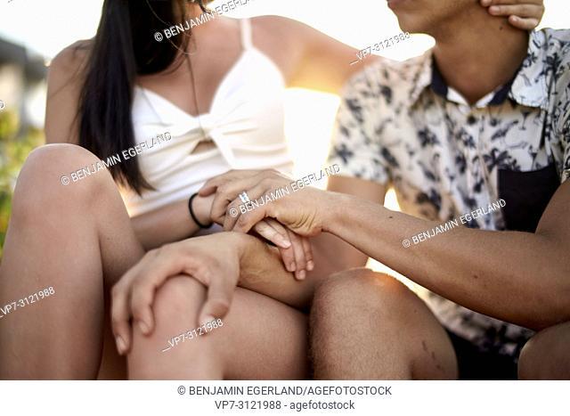 Couple holding hands, close-up, faceless. Chersonissos, Crete, Greece