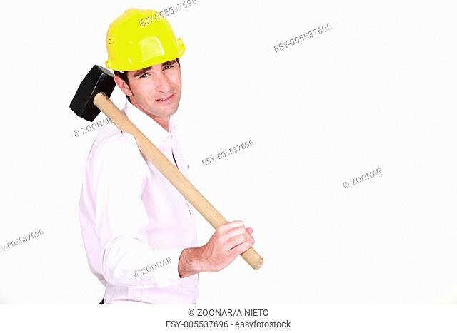 businessman holding a helmet and a hammer