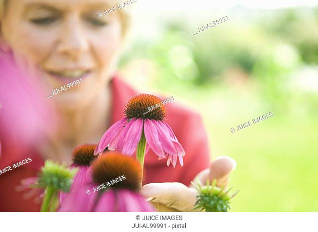Woman looking at flower