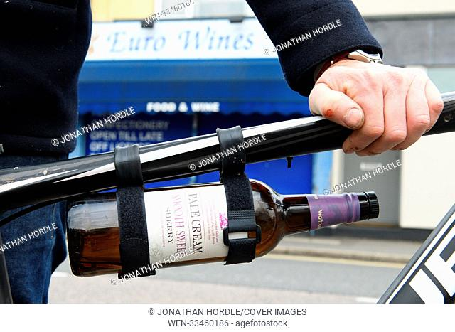 """A wacky inventor has launched a product for carrying bottles of booze to your Christmas party. Called the """"""""thingumy"""""""", the £6 universal bicycle mount can..."""