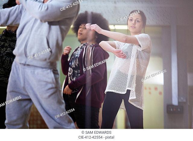 Focused teenage girl dancing in dance class studio