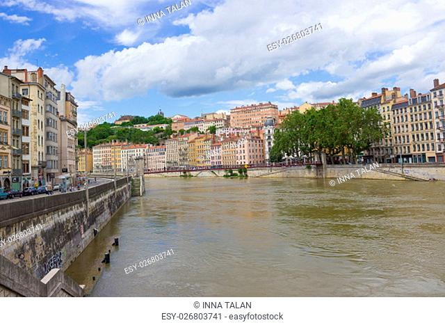 Lion, France - June 16, 2716: The view from river Sona to the bridge and Lyon city, France