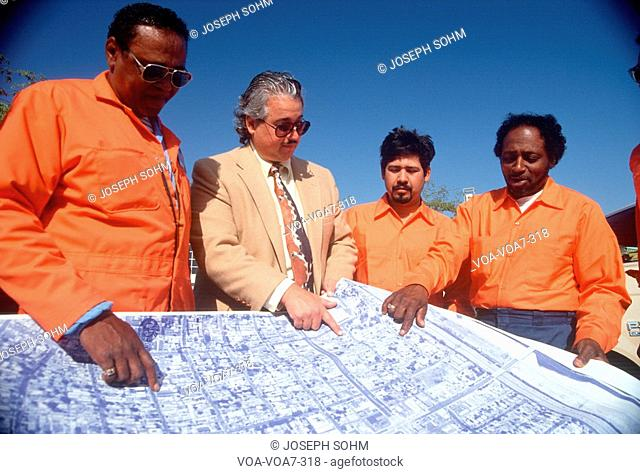 An architect reviewing the building plans with his crew