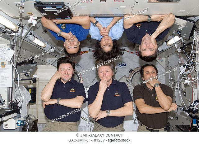Expedition 32 crew members pose for a photo in the Kibo laboratory of the International Space Station. Pictured on the bottom row are Russian cosmonaut Gennady...