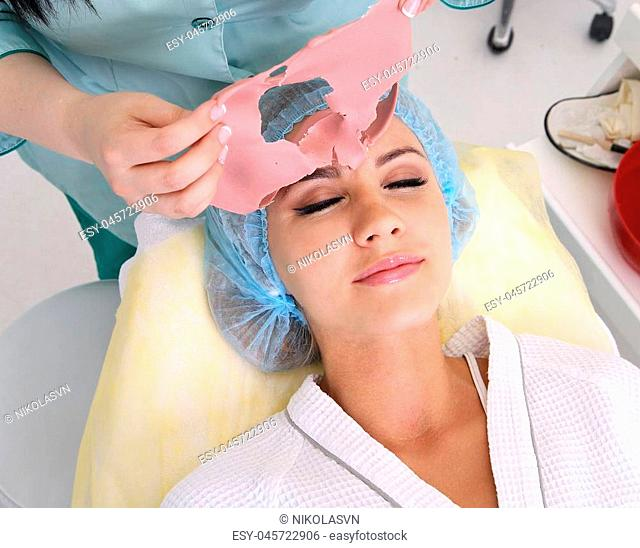 Beauty skin care cosmetics and health concept. Closeup young woman face, girl removing facial peel. Peeling