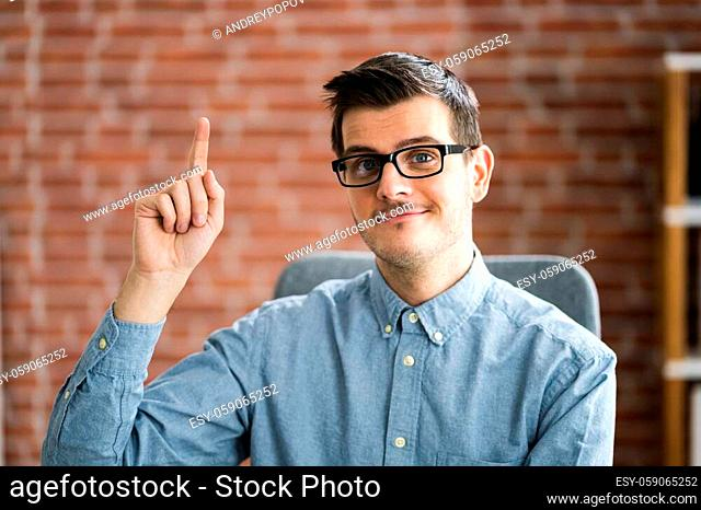 Man Raising Hand In Training Video Conference Call