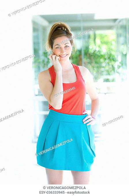 Colorful young woman smiling with red and blue dress