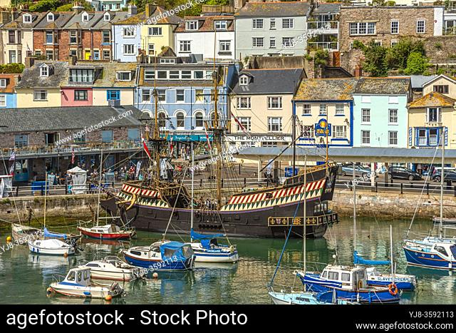 Brixham harbour and the replica of the Golden Hind at the waterfront, Torbay, England, UK